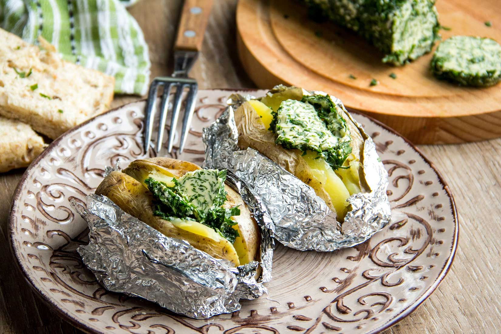 baked potatoes with herb butter