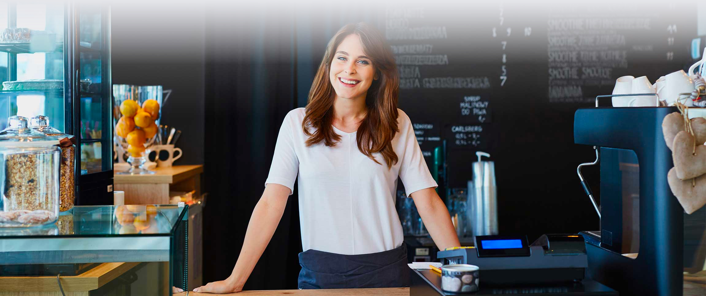 Woman standing at Coffee Shop counter