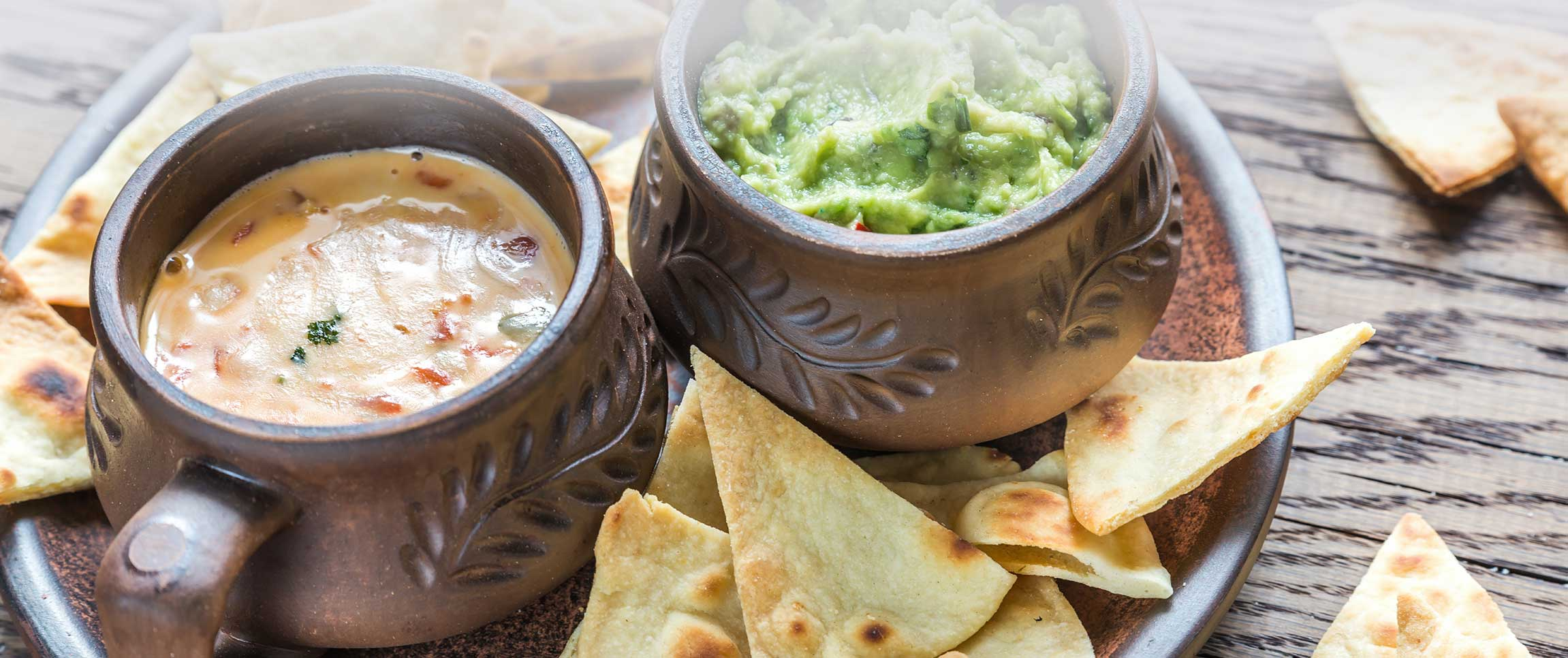 Queso Blanco Dip and Guacamole Served with Chips