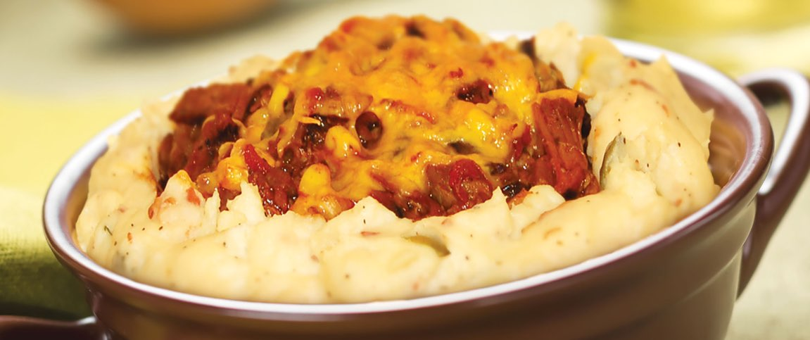 Mashed Potatoes Topped with Tomatoes and Italian Sausage