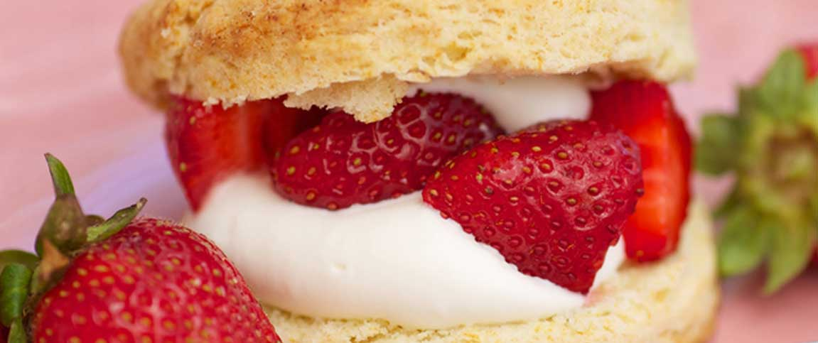 Flaky Biscuits with Icing and Strawberries