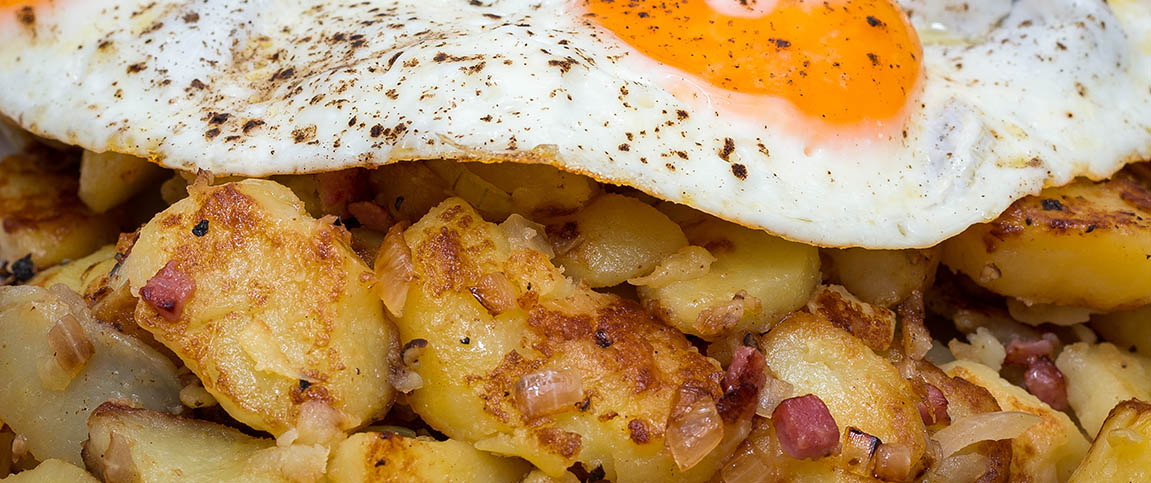 Crispy Potatoes Topped with Over Easy Eggs